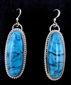 Navajo turquoise and sterling silver dangle earrings by Leonard and Raquel Hurley