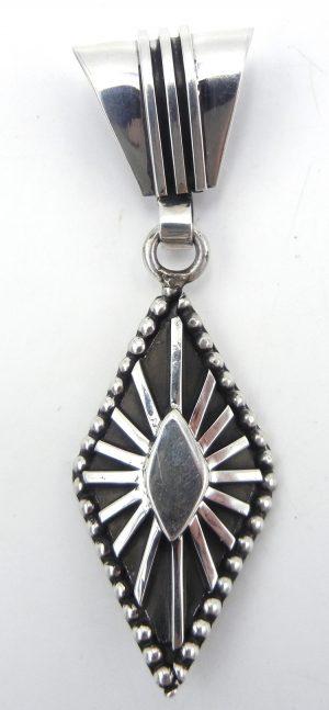 Navajo diamond shaped sterling silver pendant by Tom Hawk