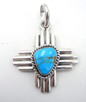 Navajo turquoise and sterling silver Zia symbol pendant by Robert Yellowhorse
