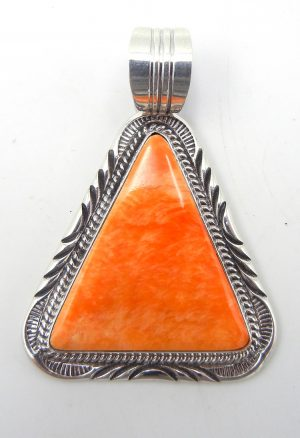 Navajo triangular orange spiny oyster shell and sterling silver pendant by Will Denetdale