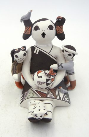 Acoma seated storyteller with two children and dog by Judy Lewis