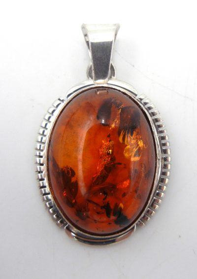 Navajo amber and sterling silver pendant
