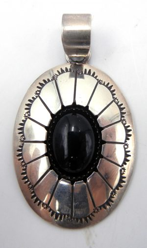 Navajo onyx and sterling silver shadowbox style pendant by Thomas Nez