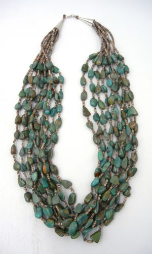 Santo Domingo 10 strand olive shell heishi and turquoise nugget necklace by Jeanette Calabaza