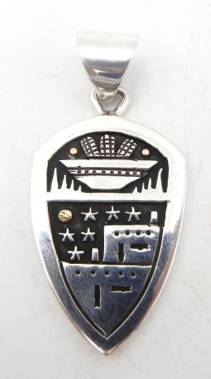 Santo Domingo sterling silver and 14k gold overlay pendant with pueblo scene and harvest basket by Joseph Coriz