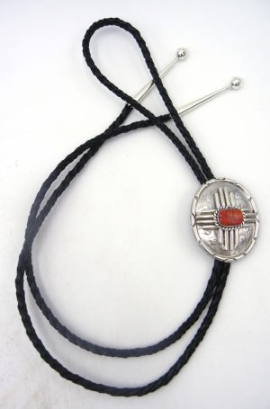 Navajo sterling silver and apple coral Zia symbol bolo tie by Robert Yellowhorse