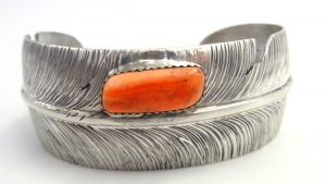 Navajo sterling silver feather cuff bracelet with orange spiny oyster shell by Ben Begay