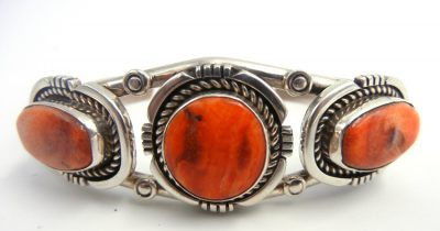Navajo three stone orange spiny oyster shell and sterling silver cuff bracelet by Art Platero