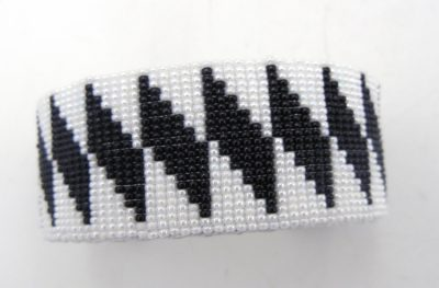 Navajo black and white beaded cuff bracelet with diagonal diamond pattern by Weltin Hoffman