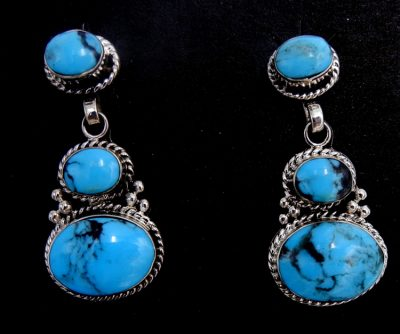 Navajo three stone turquoise and sterling silver dangle earrings by Gregg Pinto