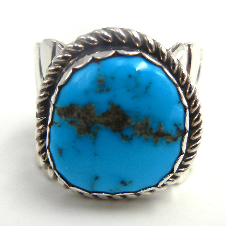 Navajo turquoise and sterling silver ring with wide feather pattern band