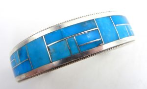 Zuni turquoise and sterling silver channel inlay cuff bracelet by Rickel and Glendora Booqua