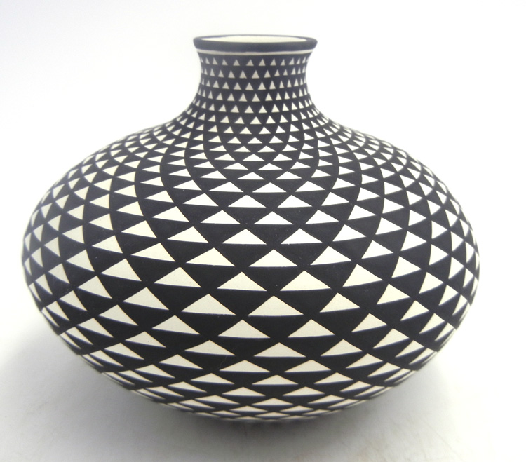Acoma black and white handmade and hand painted jar by Paula Estevan