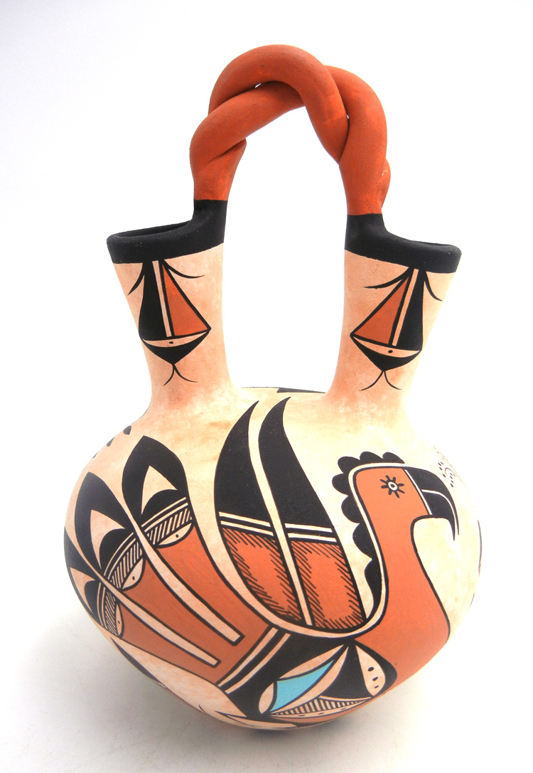 Navajo handmade and hand painted polychrome parrot design wedding vase by Westly Begaye