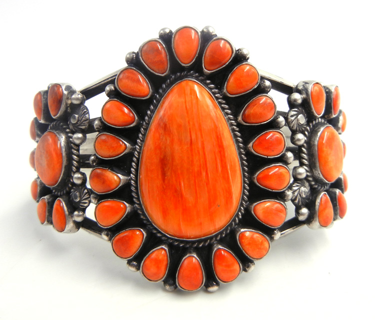 Navajo orange spiny oyster shell and sterling silver rosette cuff bracelet