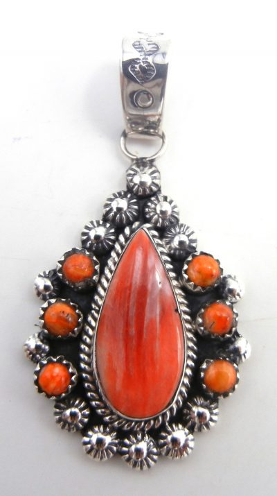 Navajo red and orange spiny oyster shell and sterling silver cluster pendant by James Martin
