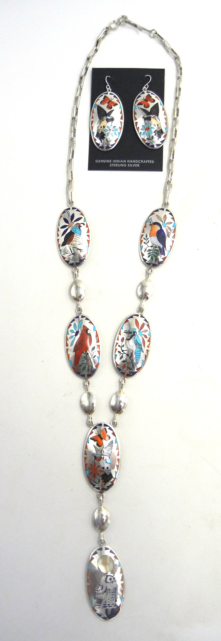 Zuni multi-stone mosaic inlay bird and sterling silver necklace and earring set by Quintin Quam