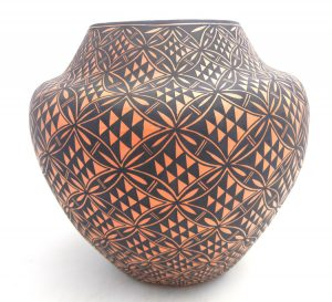 Acoma handmade and hand painted red and white floral design jar by Sharon Stevens