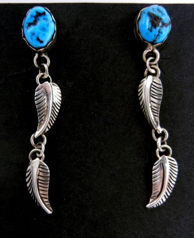 Navajo turquoise nugget and double sterling silver feather dangle earrings