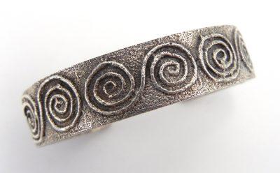 "Santo Domingo sterling silver tufa cast whirlwind cuff bracelet by Gilbert ""Dino"" Garcia"