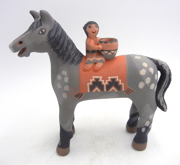 Jemez handmade horse figurine with one child and piece of pottery by Leonard Tsosie
