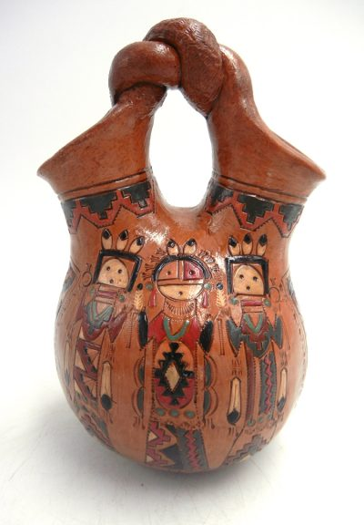 Navajo pine pitch Yei/Yeibichai and bear pattern wedding vase with twisted handle by Kenneth White