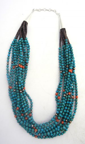 Santo Domingo turquoise, apple coral, olive shell, and brushed sterling silver twelve strand heishi necklace by Irene Lovato