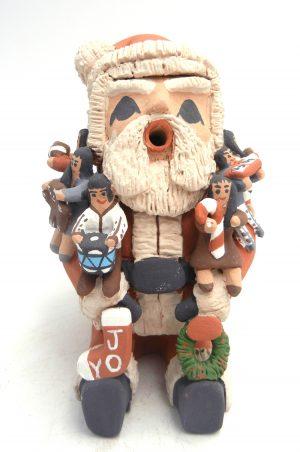 "Jemez Santa Claus storyteller with eight children by Deborah ""Kiki"" Loretto"