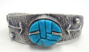 Navajo heavy gauge sterling silver tufa cast and turquoise and silver cornrow inlay cuff bracelet