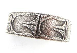 Santo Domingo sterling silver tufa cast tulip pattern cuff bracelet by Gilbert 'Dino' Garcia