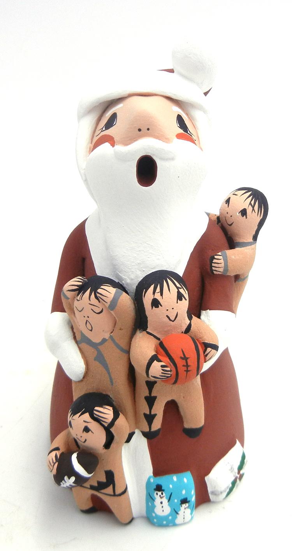 Jemez standing Santa Claus storyteller with four children by Diane Lucero