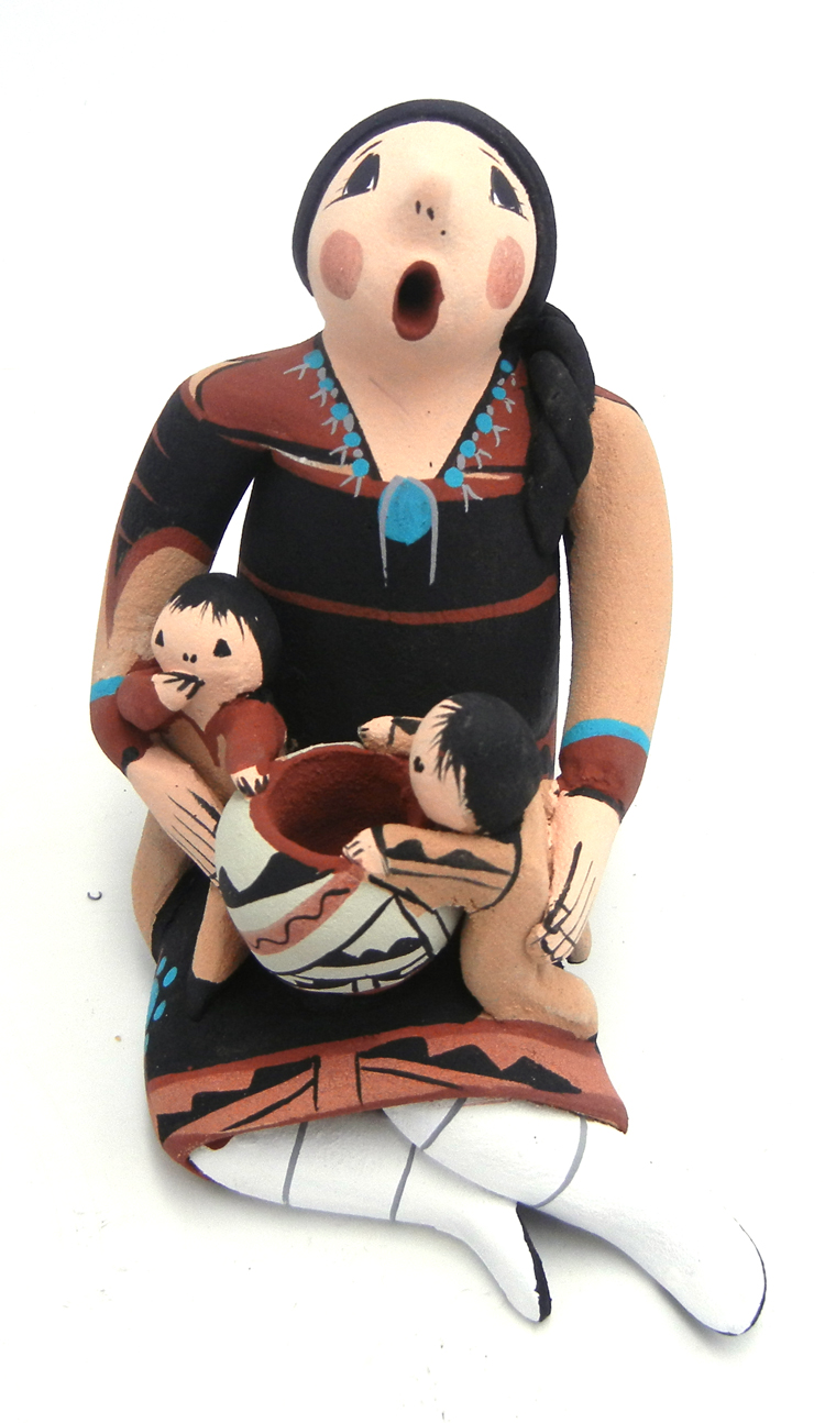 Jemez seated storyteller with two children and pottery jar by Joyce Lucero