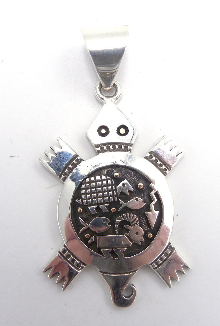 Santo Domingo sterling silver and 14k gold overlay turtle pendant by Joseph Coriz