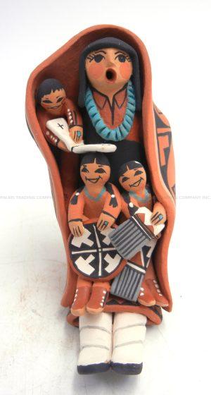 Jemez seated storyteller with three children by Carol Lucero Gachupin