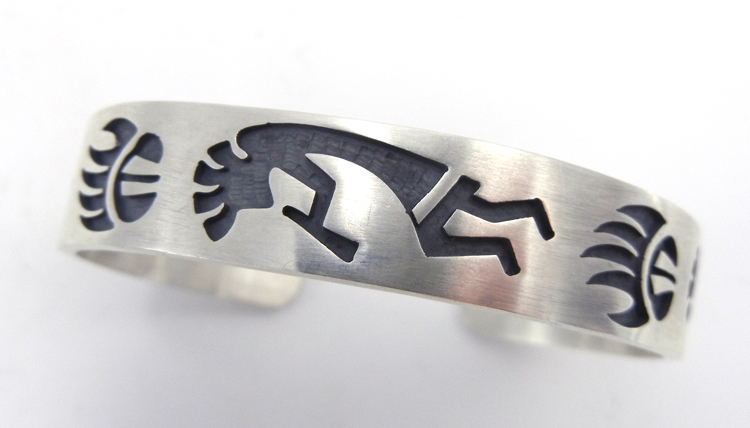 Hopi sterling silver overlay kokopelli and bear paw cuff bracelet