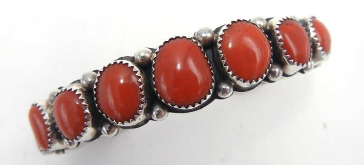 Navajo coral and sterling silver row cuff bracelet by Wilbert Muskett