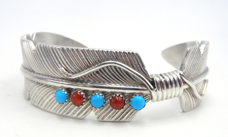 Navajo sterling silver feather cuff bracelet with turquoise and coral accents