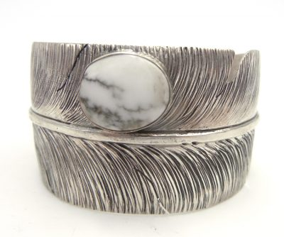 Navajo wide band sterling silver and howlite feather cuff bracelet by Ben Begay