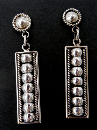 Navajo domed sterling silver dangle earrings by Thomas Charley