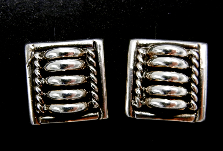 Navajo domed sterling silver post earrings by Thomas Charley