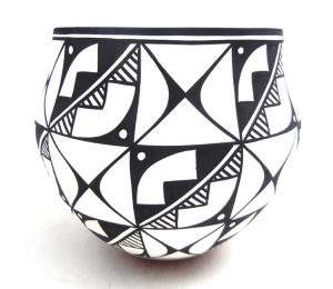 Acoma handmade and hand painted weather pattern and butterfly design jar by David Antonio
