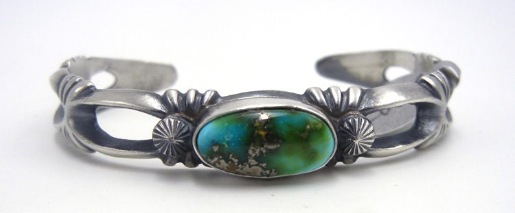 Navajo turquoise and sandcast sterling silver cuff bracelet by Harrison BItsue