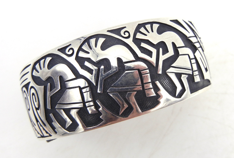 Hopi sterling silver overlay kokopelli, wave, and feather pattern cuff bracelet