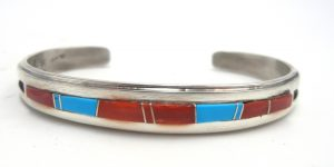 Navajo coral, turquoise, and sterling silver channel inlay cuff bracelet by Wayne Muskett