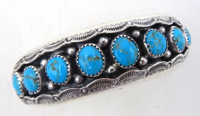 Navajo turquiose and sterling silver shadowbox style row cuff bracelet by Wilbert Muskett
