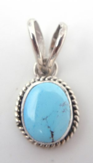Navajo small turquoise and sterling silver pendant