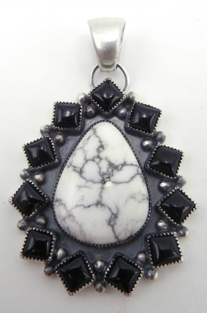 Navajo White Buffalo, onyx, and sterling silver pendant