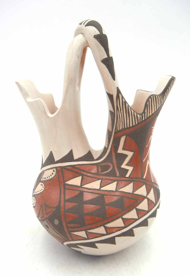 Jemez buff polished handmade and hand painted wedding vase with twisted handle by Juanita Fragua