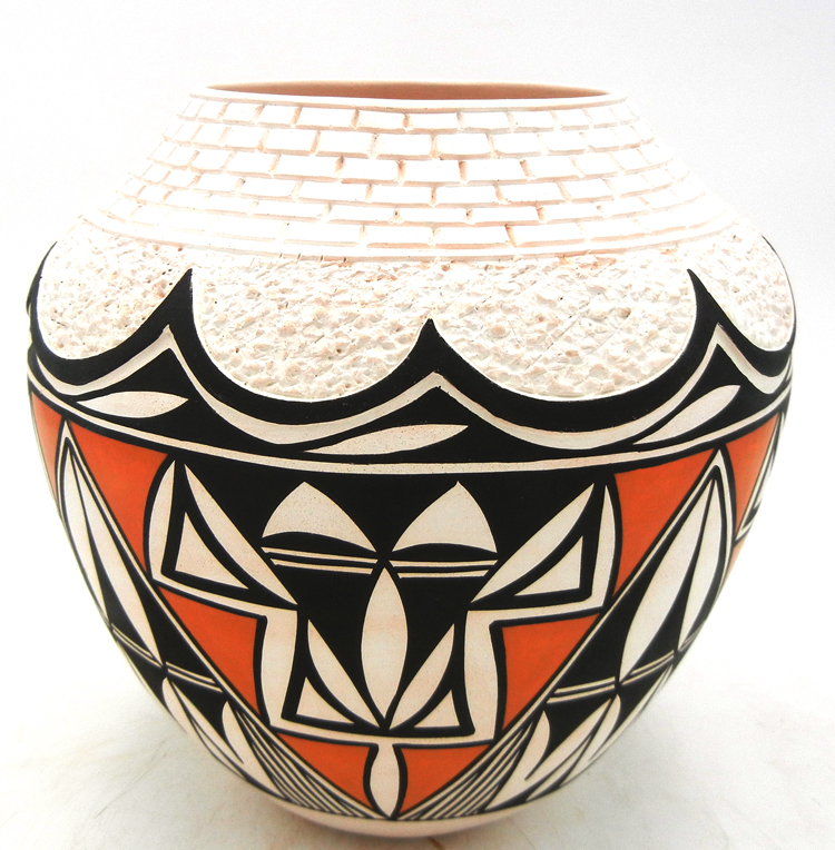 Acoma handmade and hand painted brick rim polyhcrome jar by Earlene Antonio
