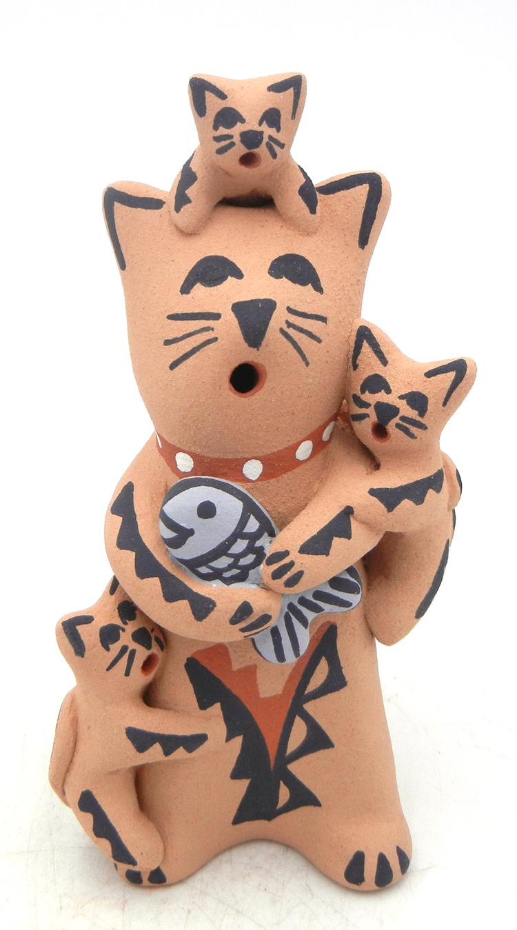 Jemez standing cat storyteller with three kittens and fish by Vernida Toya